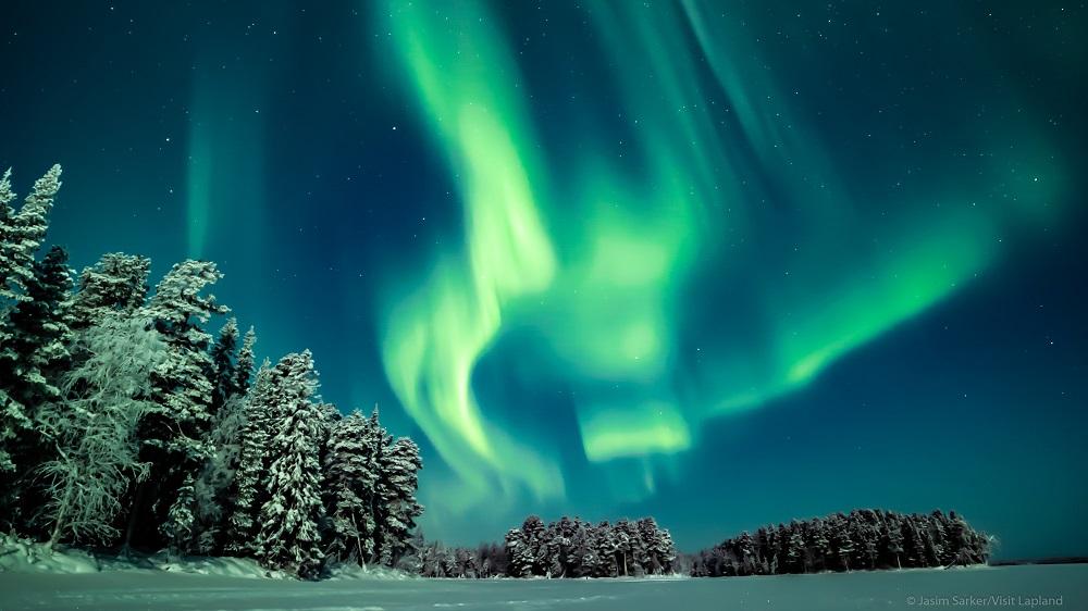 Arctic night and magical aurora in Rovaniemi, Lapland