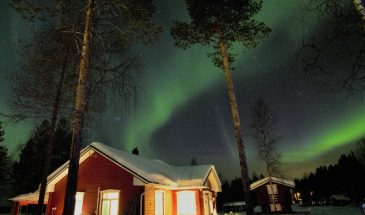 Aurora borealis adventure in finnish Lapland under the cozy cabin of Finnish Lapland northern lights magic
