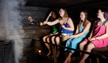 Authentic sauna and dinner in Lapland pyhä luosto girls inside the Sauna enjoying the heat