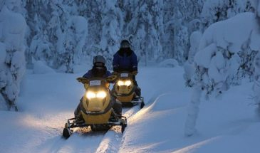 Starlight snowmobile safari kuusamo in teh snowy forest of lapland