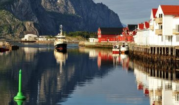 Summer Full-Day Guided Tour of the Lofoten Islands of Northern Norway cruise ship, clean water and mountains of norway and traditional red houses of north.