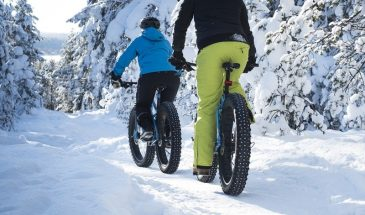 Winter Fatbike ride in Rovaniemi lapland two girls are on thebike in snowy winter weather