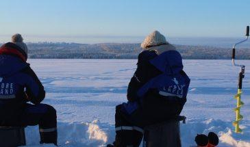 nature activities in Rovaniemi, Snowshoeing, ice fishing in the frozen lake of Finnish Lapland in winter