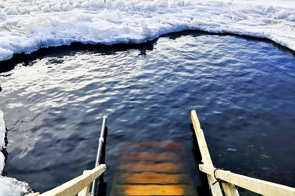 Ice swimming in Lapland in the winter