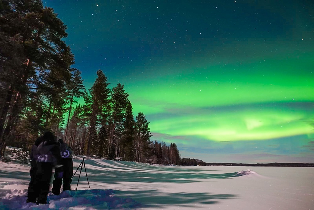 People watching northern lights in Lapland