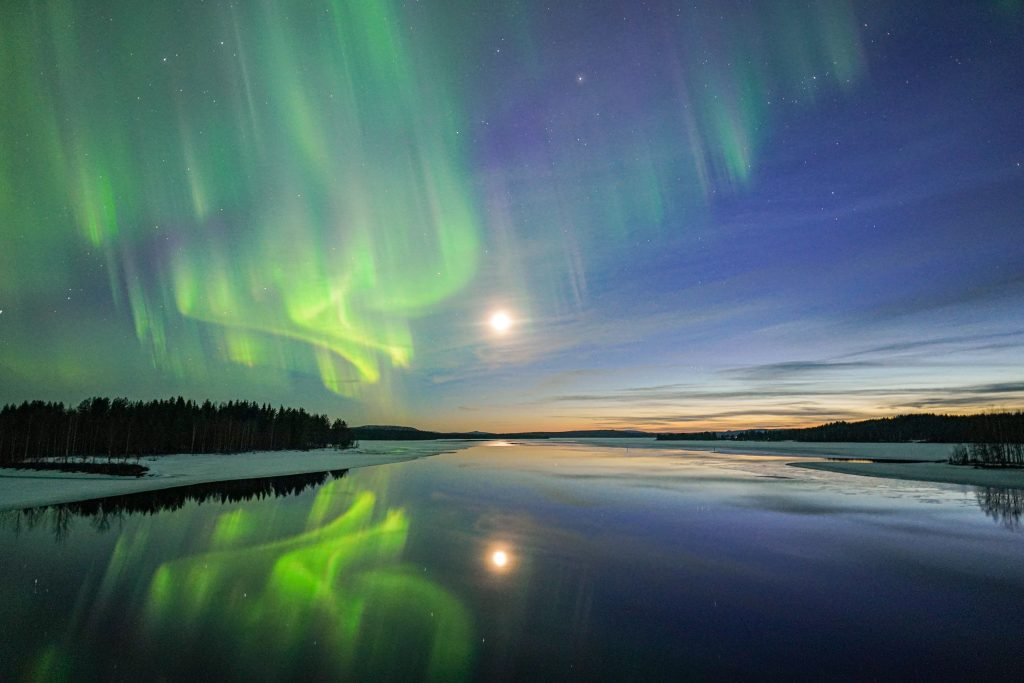 Special spot, reflection of the northern lights in a lake